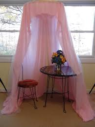 Amazing Design Of The Princess Canopy Bed With White Silk Curtain ...