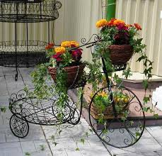 rot iron furniture. Wrought Iron Flower Pot Display, Bicycle In Vintage Style Rot Furniture S