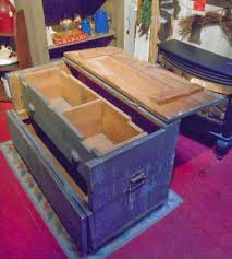 large gray wooden tool box would make a perfect coffee table one large sliding tray inside with the old drawer pulls for handy storage