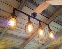 Track lighting is a favorite among design professionals and consumers thanks to its versatility and functionality. Industrial Track Lighting Ul Listed Commercial Track Etsy Rustic Industrial Lighting Rustic Industrial Lighting Chandeliers Rustic Lighting