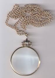 avon magnifying glass pendant necklace