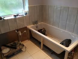 tiling around a bath with bathroom installation in leeds