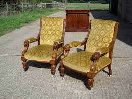 stunning pair of early period gany library chairs with lions head arms