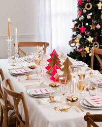 Ultra Christmas-y: Traditional and fun, this holiday table features  downsized-yet-festive Christmas trees at its center. If your dining table  is next to ...