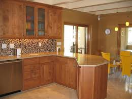 image of kitchen colors with oak cabinets and black countertops