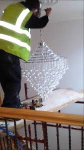 how to install a large chandelier in high ceiling by integr on equipment needed to hang