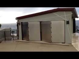 bi fold garage doorsGT5000S Automatic Bifold Garage Door  YouTube