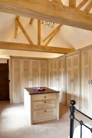 The entrance to the en-suite bathroom is encompassed within the line of  beautiful wardrobes