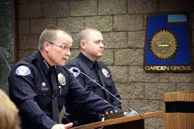 garden grove police chief todd elgin and master officer charles starnes at the garden grove city