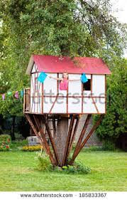 inside kids tree houses. Cute Small Tree House For Kids On Backyard. Girl Inside. Inside Houses -