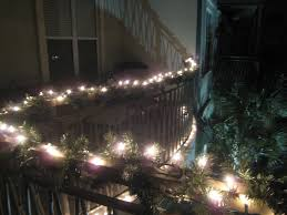fence lighting ideas. exteriorgreat christmas garland lights at black metal fence for inspiring patio ideas great lighting