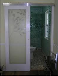 claremont glass door hung with modern barn door style hardware cool bathroom