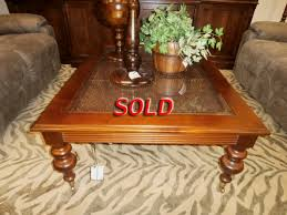 ethan allen rattan coffee table at the