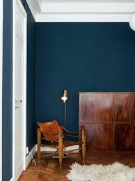how to paint over dark walls cozy corner with leather chair and a dark blue wall