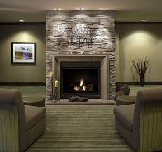 floor to ceiling stone fireplace decoration fireplace designs with brick lounge chairs in living home designing inspiration