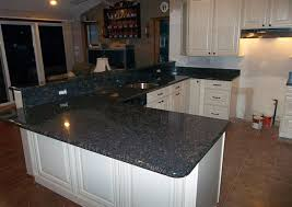 white cabinets with tan brown granite