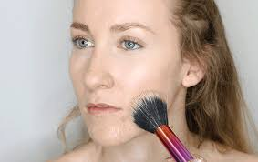 take a small amount of foundation and use your foundation brush to carefully dab a little of the formula on to diffe areas of your face starting at the