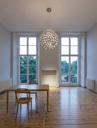 elaine led pendant lamp with polished reflectors in direktorenhaus berlin by daniel becker design studio for becker lighting