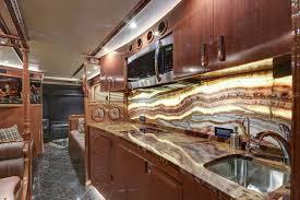 onice fantastico onyx countertop and backsplash tan brown granite flooring photo courtesy of florida