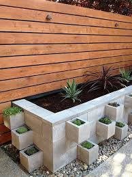 he made this ugly cinderblock wall beautiful with more cinderblocks page 2 of 2 gardening cinder block garden front yard landscaping