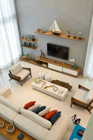 view in gallery floating wooden shelves in the living room with nautical themed decoration