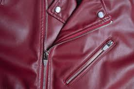 close up of a maroon red leather jacket this is a page about how to remove permanent marker