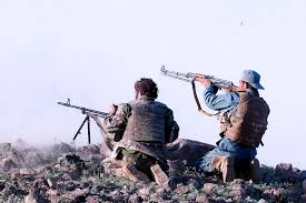 u s department of defense photo essay  an afghan ier and an afghan policeman fire on insurgent positions during a in s ghazni