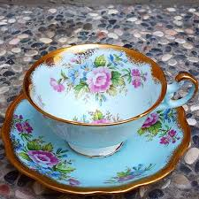 Decorating With Teacups And Saucers Vintage blue teacup by EB Foley with flower decoration around the 54