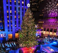 At the 80th Annual Rockefeller Center Christmas Tree lighting, an  80-year-old, 80-foot-tall Norway spruce began to glisten in New York City.