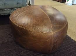oval brown leather ottoman sold