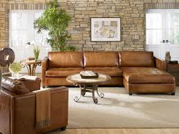leather sofa sectional light brown colored sofas circle table artistic painting grey carpet makes good combination