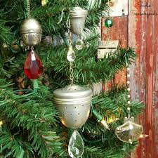ornaments using vintage tea strainers and chandelier crystals