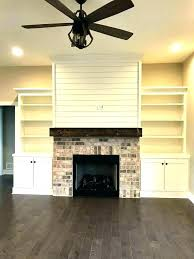 tv over fireplace next to fireplace ideas above fireplace decor medium above fireplace decor photo design