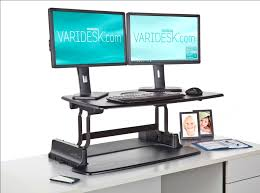 stand at desk to work up desks benefits lower health care costs 11