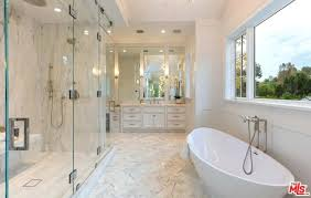 bathtub in shower elegant pure white master bathroom with freestanding tub and walk in shower along