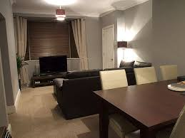 grey and brown furniture. grey walls with brown leather furniture and o