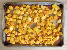 ernut squash on baking sheet