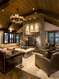 rustic interior design neutral colors beige area rug sofa armchairs stone fireplace