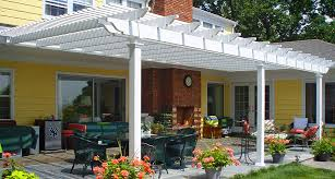 attached pergola kits attached vinyl patio cover in white with square posts over backyard patio yellow wall decorate white terrace home pergola design
