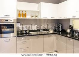 modern kitchen furniture. Modern Kitchen Furniture With Contemporary Kitchenware Like Hood, Black Induction Stove And Oven In House I