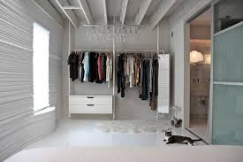 transform one wall into a boutique inspired closet with a combination of hanging rods shelves and drawers