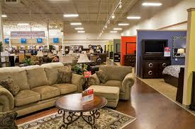 Conn s moves to Aurora to expand their reach in tight furniture