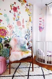 add a girlish accent to this nursery with bold floral wallpaper