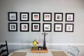 if you re looking for a gallery wall with a uniform look check out this lovely display featuring two neat rows of photos in black frames