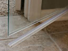 can you remove plastic strip at the bottom of glass shower door