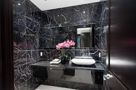 black modern powder room with simple granite counters and vessel sink