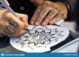 Alicante Tattoo Fair Circa 2018 Tattoo Artist Drawing A Sketch