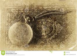 macro image of old vine pocket watch on antique book top view retro filtered image old style photo
