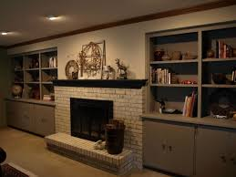 chalk paint brick fireplace and built ins traditional family room