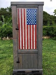 wooden pallet cabinet with country flag painted front door